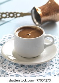 greek coffee served in a traditional cup