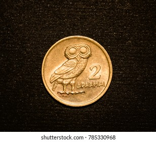 Greek coin depicting the sacred owl of the goddess Minerva