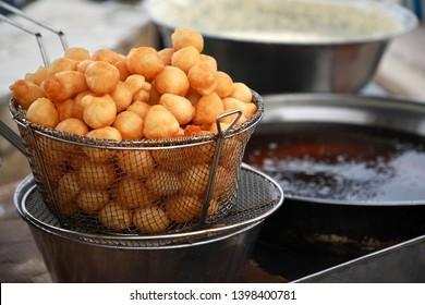 Greek donuts with honey .Street food.