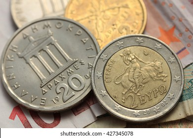 Greek Drachma and euro coin on bank note
