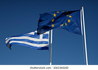 Greek and European flag waves in airport of Astypalaia, Greece on July 29, 2017