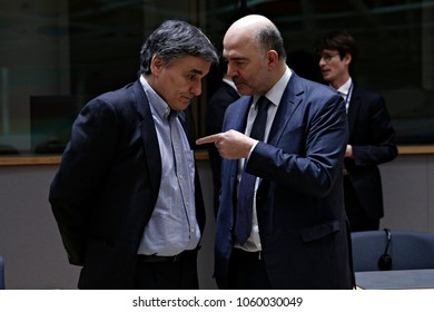 Greek Finance Minister Euclid Tsakalotos Eurogroup talks with Commissioner Piere Moscovici during a  finance ministers meeting at the European Council in Brussels, Belgium on Feb. 20, 2017.