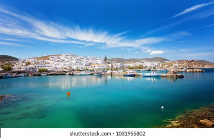 Greek fishing village Naousa, Paros island, Greece - Panoramic view of idyllic old port with moored traditional boats