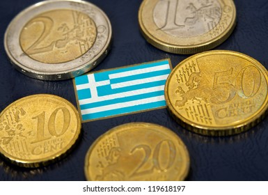 Greek flag and euro coins over blue background
