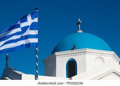 Greek flag flying at top of a greek orthodox church