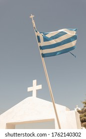 Greek flag on a white church in Santorini Greece