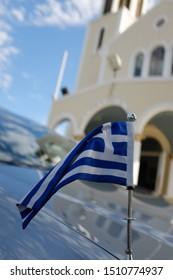 Greek flag with orthodox church in background