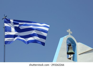 greek flag and a small church