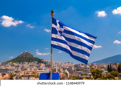 Greek flag waving waving over the city of Athens, the Greek capital