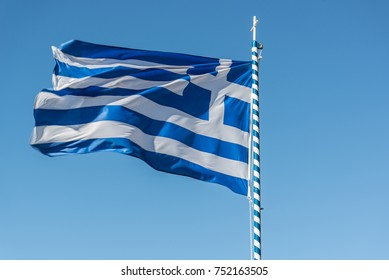 Greek flag waving under clear sky