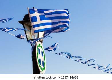 Greek flags waving outdoor on strings during summer weather. Greece European country national landmark