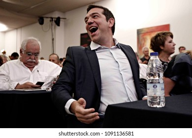 Greek former Prime Minister Alexis Tsipras reacts during a meeting with members of his Syriza party in Athens, August 29, 2015.