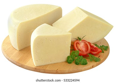 Greek graviera cheese on a wooden round plato decorated with sliced tomato and parsley.Isolated and clipping path.