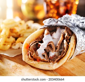 greek gyro with fries close up