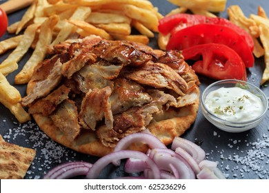 Greek gyros dish on a black plate