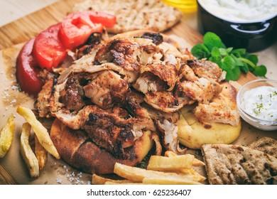 Greek gyros dish on a wooden background