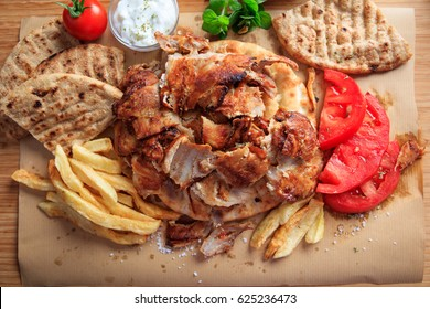 Greek gyros dish on a wooden background - top view