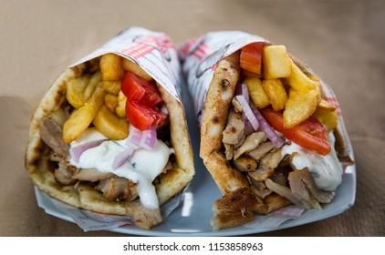 Greek gyros pita with chopped meat, french fries, tomatoes and tzatziki sauce