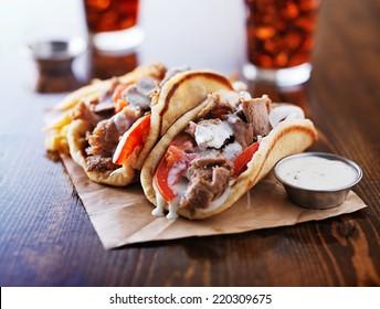 greek gyros with tzatzikii sauce and fries
