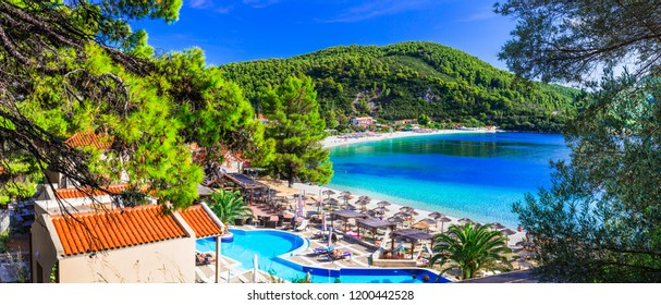 Greek holidays - beautiful Panormos bay. view with hotel and beautiful beach. Skopelos island, northen Sporades of Greece