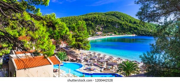 Greek holidays - beautiful Panormos bay. view with hotel and beautiful beach. Skopelos island, northen Sporades of Greece