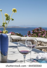 Greek Island Dining  A view of the Aegean sea in the background. Outdoor table setting on Greek island of Mykonos.