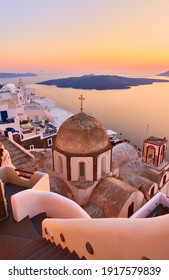 Greek landscape with Fira town on the coast of Santorini island by the sea at dusk, Greece