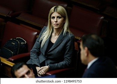 Greek lawmaker Elena Rapti attends in a discussion before a budget vote in Greek Parliament in Athens, Greece on Dec. 1, 2015