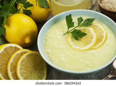 Greek lemon soup with parsley in the bowl