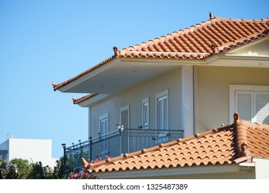 Greek, Mediterranean architecture. Houses in a seaside resort in Greece. Beige colored homes.