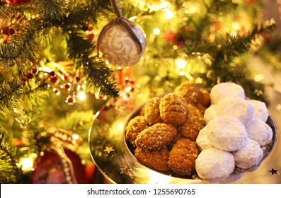 greek melomakarona and kourabies - traditional Christmas cookies with honey and nuts and sugar buns