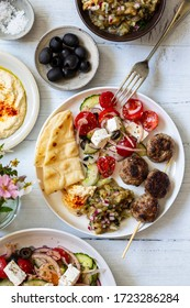 Greek meze meal with lamb meatballs, hummus and salad