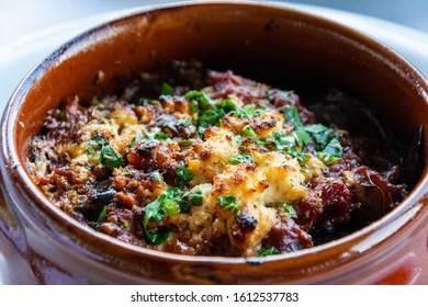 Greek moussaka in a clay pot.