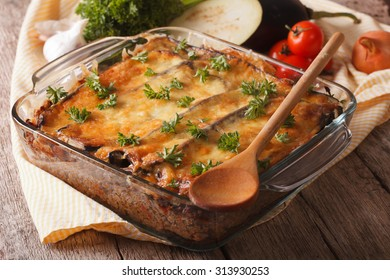 Greek moussaka close up in baking dish with the ingredients on the table. horizontal
