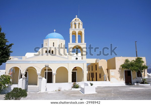 A Greek Orthodox church, with associated accommodation, at Oia, on the Aegean holiday island of Santorini.