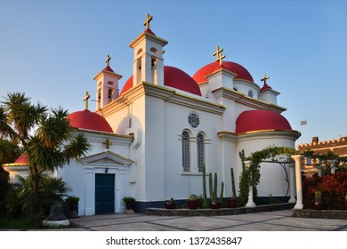 The Greek Orthodox Church of the Holy Apostles in Capernaum near the shore of the Sea of Galilee in Israel shown at sunset