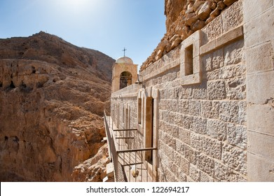 The Greek Orthodox Monastery of the Temptation perches on a desert mountain cliff overlooking the West Bank town of Jericho.