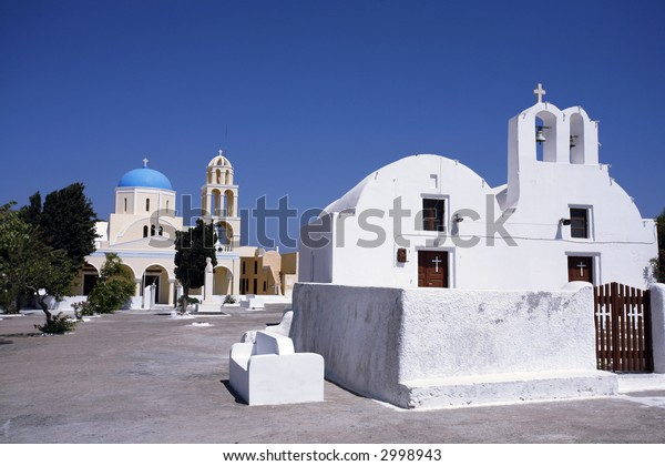 A Greek Orthodox religious community at Oia, on the holiday island of Santorini.