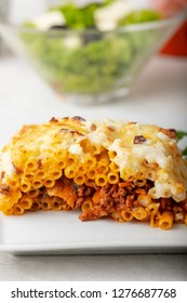 greek pastitsio with salad on a plate