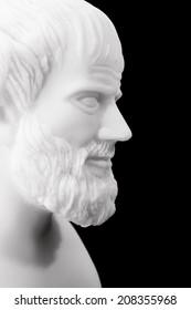 Greek philosopher Aristotle (384-322 B.C.E.) sculpture isolated on black background