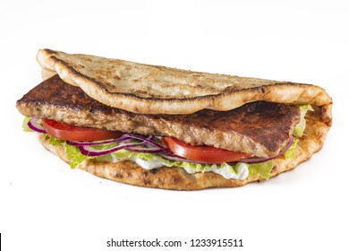 Greek pita with meat, salad, tomato and sauce isolated on white