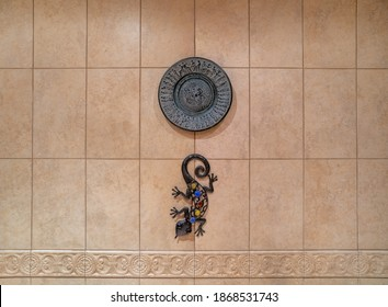 Greek plate on a tiled wall
