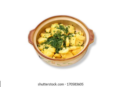 Greek potato salad with dill in a bowl isolated