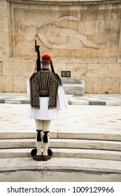 Greek Presidential Guard (evzone) in national clothes uniform at the tomb of unknown soldier in Athens, Greece. Ceremonial ritual changing guards.