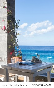 Greek restaurant, food taverna and caffe, above the beach in summer