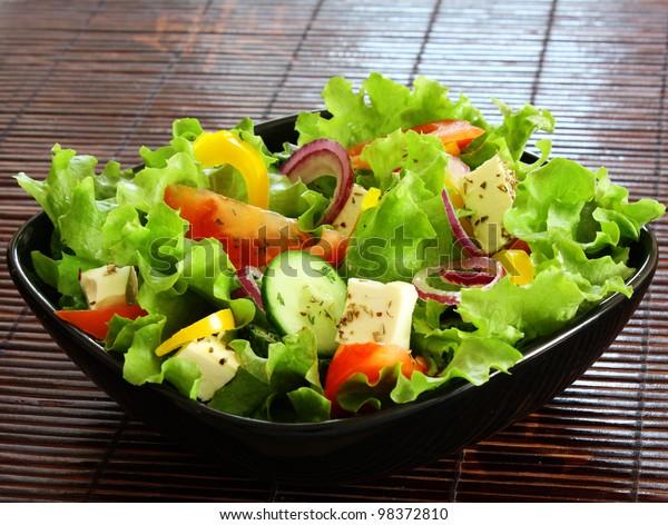 greek salad in black plate