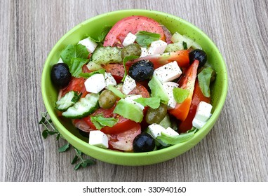 Greek salad with cheese, tomato, cucumber and olives