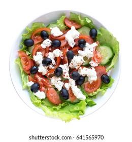 Greek salad closeup. Isolated on white background