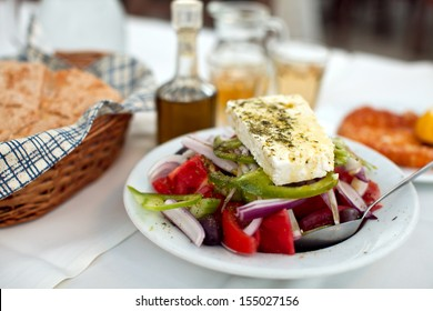 Greek salad with country bread and home made white wine