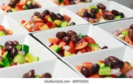 Greek Salad entree prepared for big function in restaurant.